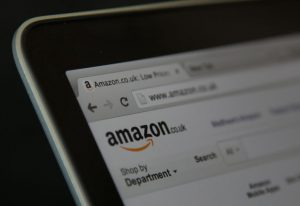 BRISTOL, UNITED KINGDOM - AUGUST 11: In this photo illustration a laptop displays the Amazon website on August 11, 2014 in Bristol, United Kingdom. This week marks the 20th anniversary of the first online sale. Since that sale - a copy of an album by the artist Sting - online retailing has grown to such an extent that it is now claimed that 95 percent of the UK population has shopped online and close to one in four deciding to shop online each week. (Photo Illustration by Matt Cardy/Getty Images)